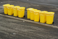 Yellow recycling bin Stock Images