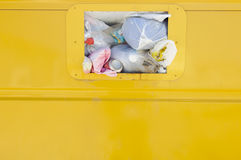 Yellow recycling container. Detail of a yellow recycling container overflowing Royalty Free Stock Photography