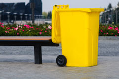 Yellow recycling container Stock Photo
