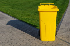Yellow recycling container Royalty Free Stock Image