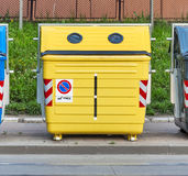Yellow recycling container on the street. Close Stock Image