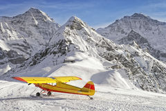 Yellow red airplane at the mountain airfield in swiss alps Royalty Free Stock Photography