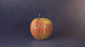 Yellow-Red Apple with eyes Stock Photo