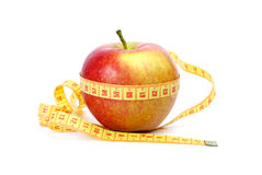 Yellow-red apple and measurement tape Stock Images