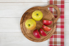 Yellow and red apples laid on a cutting wooden board. Table decoration royalty free stock photography