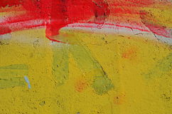 Red stripe on yellow. Red stripe of graffiti paint airbrushed on yellow background stock photos