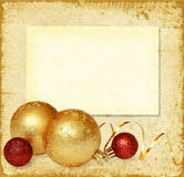 Yellow and red balls with golden ribbon Royalty Free Stock Photo