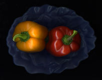 Yellow and Red Bell Peppers Stock Photography