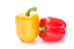 Yellow and red bell peppers. On a white background Royalty Free Stock Photo