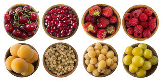 Yellow and red berries isolated on white background. Collage of different fruits and berries. Cherry, strawberry, pomegranate, red currant, raspberry, apricot Stock Photo