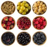 Yellow, red and black food. Berries isolated on white background. Collage of different colors fruits and berries. Strawberries, currants, raspberries, yellow Royalty Free Stock Images