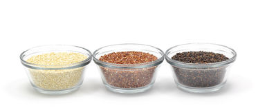 Yellow, Red, and Black Quinoa. In glass bowls isolated on a white background royalty free stock photo