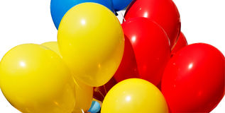 Yellow red and blue balloons. Isolated on a white background stock photo