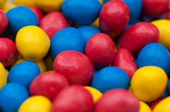 Yellow, red and blue goodies royalty free stock photography