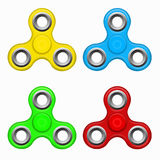 Yellow, red. blue, green colorful spinners on a white background.. Hand fidget spinner toy - stress and anxiety relief. Yellow, red. blue, green colorful Stock Images