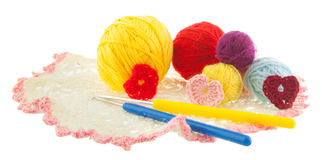 Yellow, red, blue, grey ball of yarn, crochet red, pink hearts o Royalty Free Stock Photo