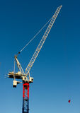 Yellow red and blue hoisting crane. Against clear blue sky, Kings cross, England Royalty Free Stock Photography