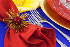 Yellow, red and blue place setting Stock Image