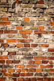 Yellow and red brick wall Stock Images