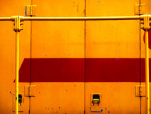 Yellow and Red. Bright yellow and red painted pattern on side of a train car Stock Photography