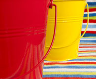 Yellow and red buckets stripy beach towel. Stock Photography