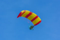 Yellow and red canopy powered tandem para glider Stock Images