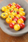 Yellow and red cherry tomatoes Royalty Free Stock Image