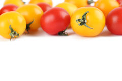 Yellow and red cherry tomatoes border Royalty Free Stock Image