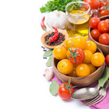 Yellow and red cherry tomatoes in bowl, olive oil and spices Royalty Free Stock Photo