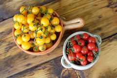 Yellow and red cherry tomatoes Stock Image
