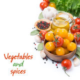 Yellow and red cherry tomatoes, olive oil, herbs and spices Stock Photos
