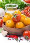 yellow and red cherry tomatoes, olive oil and spices, close-up Royalty Free Stock Image