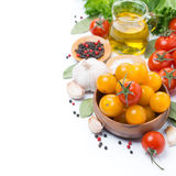 Yellow and red cherry tomatoes, olive oil and spices, isolated Stock Image