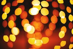 Yellow and red circle and oval shape of defocused lights abstract background. A group of circle and oval shape from red and yellow lights defocused abstract royalty free stock photos