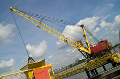 Yellow and red crane Stock Photos