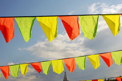Yellow and red flags. Blue sky background. Royalty Free Stock Photo