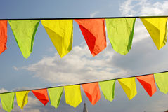 Yellow and red flags. Blue sky background. Royalty Free Stock Photos