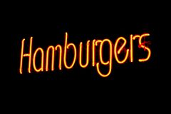 Yellow and Red Flourescent Hamburger Sign. A yellow and red flourescent Hamburgers sign Royalty Free Stock Photo