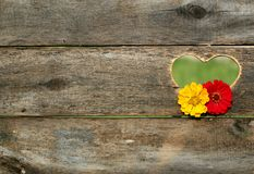 Yellow and Red Flower on Brown Heart Wooden Carved Panel Stock Images