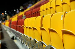 Yellow and red grand stand seats Stock Photos