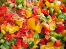 Yellow, red and green Bulgarian pepper in skillet. Royalty Free Stock Image