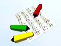 Yellow, red and green pen markers on a list with highlighted elements Royalty Free Stock Photography