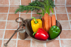 Yellow, red and green peppers and carrots Royalty Free Stock Photography
