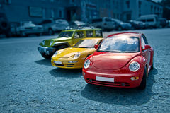 Yellow, red and green toy cars. A picture of toy car models Stock Photo