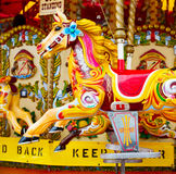 Yellow red horse attraction painted carousel leisure for the kid Stock Photo