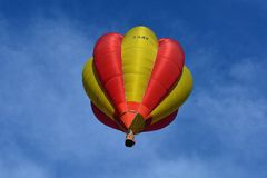 Yellow and Red Hot Air Balloon in Sky Stock Photography