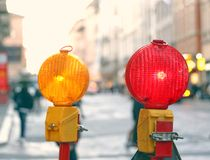 Yellow and red lamp in roadworks in the city Stock Photo