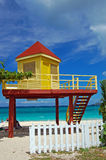 Yellow and red lifeguard booth on Grand Anse Beach Stock Photography