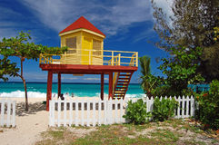 Yellow and red lifeguard booth on Grand Anse Beach Royalty Free Stock Photography