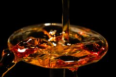 Yellow and red liquid pouring macro. Yellow and red liquid pouring close Stock Photos